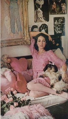 Marisa Berenson in a pink Oscar de la Renta dress with pet shih tzu , Photo by Helmut Newton. Vogue 1973