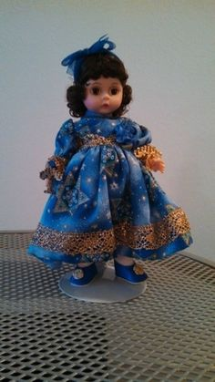 Madame Alexander doll with Chanukah dress and accessories