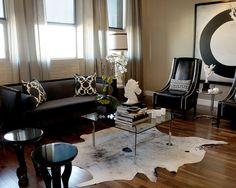 Featured, Elegant Black Comfy Sofa Wooden Floor And Cowhide Rug Rugs Elegant Interior Ideas Use Cowhide Rug Ideas: Cool Cowhide Rug will Makes Amazing Interior Decorations Ideas