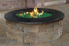 "Prepackaged Olde English Round Gas Fire pit Kit. Made from Olde Engilsh Radius Wallstones. 32"" diameter, 48"" outside diameter, 16"" high."