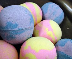 F: When this bath bomb is dropped into water, the solid particles that shape the bomb dissolve, allowing ions in the bomb to disperse. These ions collide, neutralizing and creating the 'fizzing' reaction. This part of the reaction produces carbon dioxide gas, which is why bubbles are formed. The chemical equation for this reaction is 3NaHCO3 + C6H8O7 --> 3CO2 + C6H5Na3O7 + 3H2O. Sodium bicarbonate and citric acid are the reactants and carbon dioxide, sodium citrate and water are the…