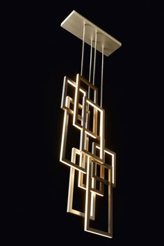Edge suspension lamp by Oasis, design by Massimiliano Raggi. LED lights diffused by a structure of aluminum, bronze and antiqued gold.