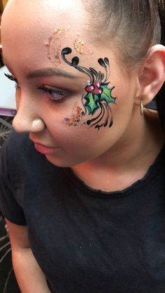 Christmas holly face painting