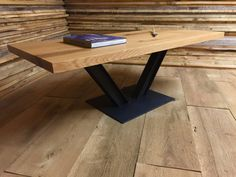 IN STOCK-Modern industrial coffee table featuring reclaimed wood top and steel I-beam base.