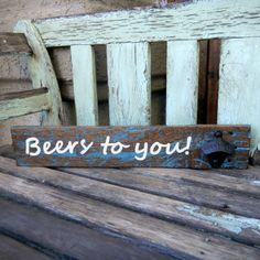 "This sign is already sold, but I would love to make another one just for you!  Rustic pallet wood sign distressed reclaimed wood with cast iron bottle opener ""Beers to you!"" on Etsy, $27.00"