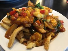 Charles Dickens Pub is a great stop for all things pub fare and cheesey.  Try out their poutine featuring Gunn's Hill cheese curds and several other menu items using local cheese.