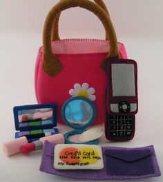 Felt purse & makeup set - My daughter has this and loves it! The most creative and wonderful handcrafted stuff I've seen. (Made by my sister!)
