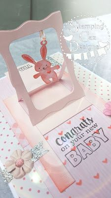 handmade baby card from A STAMPING & CHIRPING Corner . luv the Hanging Charm Pull Tab format she used . pink and white with ink of gray . luv the frame with a dangling bunny . Fancy Fold Cards, Folded Cards, Baby Pop, Slider Cards, Interactive Cards, New Baby Cards, Baby Shower Cards, Welcome Baby, Pop Up Cards