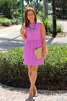 top a classic dress with a gorgeous statement necklace