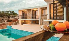 """""""Fari Exclusive Villas"""" is a stunning complex at a very privileged location, that comprises of six very special villas. The amphitheatrical land plot that hosts the complex covers an area of 15.600sqm and features captivating natural beauty, privacy andunrestricted view to the sea."""