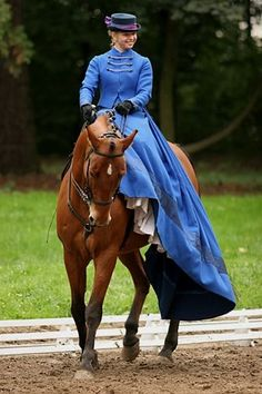 Sidesaddle in a beautiful blue riding habit. The style is becoming more and more popular in the show rings.