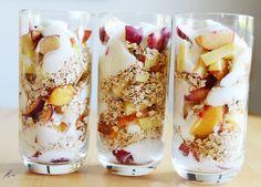 fresh, healthy breakfast parfait of stonefruit, yoghurt and oats