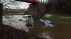 Submerged: Vehicles stuck in floodwaters between Dyce and Balmedie.