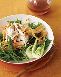 Chinese Chicken Salad Recipe on Food & Wine| The Good News The chicken in this crunchy salad stays flavorful and moist even though it's cooked without extra fat because the Tender Greens chefs poach it with the skin on (removing it before serving).