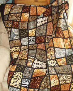 Twin Size Bed Quilt -- Jungle Animal Prints in Mosaic Crazy Nine Patch Pattern. $450.00, via Etsy.