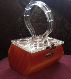 lucite purses from the 50's   ... com a nice lucite and amber bakelite purse top is lucite with a cross
