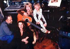 a lovely family photo, taken many years ago; Stevie holding a guitar with her little niece Jessica in pj's at the back and Stevie's brother Chris Nicks and his then-wife, Lori Perry-Nicks; Lori has been one of Stevie's back-up singers for decades   ☆♥❤♥☆