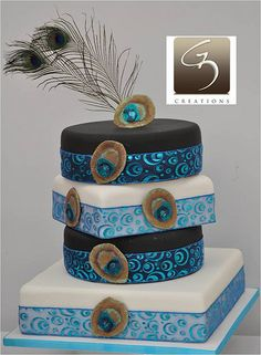 white and teal peacock feather wedding cake Weddings Dreams