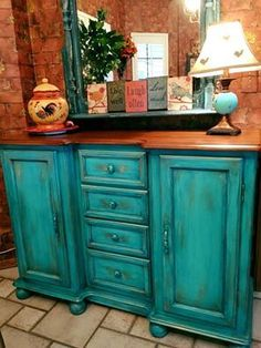 CeCe Caldwell's Santa Fe Turquoise with Thomasville Teal washed over it then enhanced with Bingham Canyon Copper metallic wax. Designed by Lynn Bell.