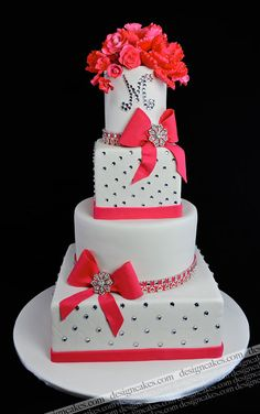 Monogrammed 4-Tier Wedding Cakes: Alternating shaped tiers with coral accents / Design Cakes
