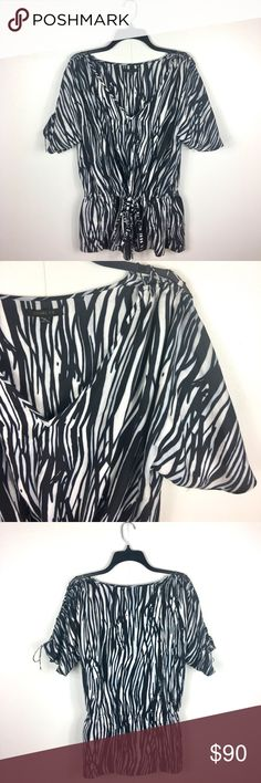 """[Rachel Zoe] Black & White Abstract Drawstring Top Rachel Zoe Black & White Abstract Drawstring Top • Size: 10 • Color: Black/white • Condition: EUC • Measurements: 24"""" bust, 14"""" (when tied; otherwise not fitted), 29"""" shoulder-to-hem length  Drawstring waist with tie. Lace up detail with tie on each sleeve.  *All measurements are approximate Rachel Zoe Tops Blouses"""