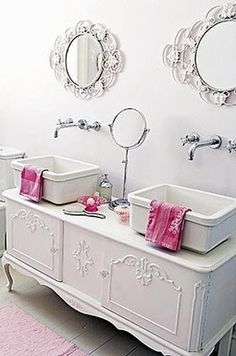 Cottage Bathtub Design: A wide ledge is a good way to create a comfortable and safe means to get into a deep bathtub. It also creates an attractive and highly functional architectural detail in even the smallest bathroom. Here the apron in front of the tub matches the wood panels surrounding it to create an integrated look.