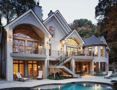 This house is gorgeous- love the balcony, big windows, stairs, and patio area.