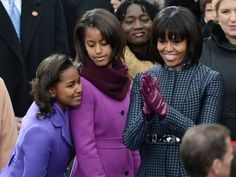 First Lady of the United States, Michelle Obama, with daughters Malia and Sasha on Inauguration Day 2013.