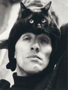 "(German photographer Herbert Tobias and his cat, Tobias.) * * TOBIAS: "" HE PUTS MEEZ HERES. ME THINKS DE SAUERKRAUT HE ATES FER LUNCH WENTS TO HIZ BRAIN."""