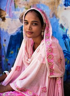 A muslim woman in pink robes and headscarf in Pushkar
