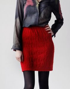 This unique slim fitted knit skirt will bring u warm and feminin through the winter time. The red knitted pattern is inspired by exotic animals and made out of wool. The wide cuffs keep it comfortably. Made in Spain.         $59.00 € EUR