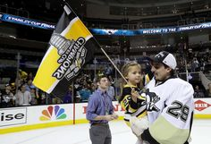 JUNE 12: Marc-Andre Fleury #29 of the Pittsburgh Penguins and guest celebrate after the Penguins defeat the San Jose Sharks 3-1 to win the Stanley Cup in Game Six of the 2016 NHL Stanley Cup Final at SAP Center on June 12, 2016