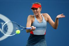 Maria Sharapova Photos: US Open: Day 3. Maria Sharapova of Russia returns a shot against Alexandra Dulgheru of Romania during their women's singles second round match on Day Three of the 2014 US Open at the USTA Billie Jean King National Tennis Center on August 27, 2014 in the Flushing neighborhood of the Queens borough of New York City.