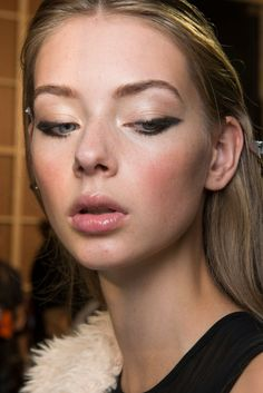 Intense winged eyeliner and glossy lips at Elie Saab S/S 2017