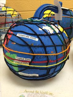 Fifth grade Common Core project based learning for social studies. Pumpkin globe project. Different colored yarn for equator, prime meridian, Tropic of Cancer, Tropic of Capricorn, longitude/latitude. Label climate zones and hemispheres, as well as oceans. Create map key and a compass rose to display with the globe. Finally, create a business card for the members of the cartography team.