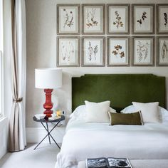 dont like the table lamp, dont like too many pics above headboard, but like the colour , green!