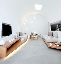 Santorini House Painted in White restored house living room concrete floor
