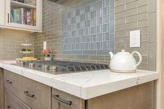 Subway Tile Backsplash in Two Colors Against a White Eased Edge Quartz Countertop Photo by Preview First #countertop