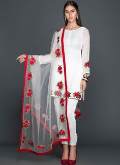 White Floral Georgette Pant Suit features a beautiful georgette top alongside a dhupioni silk bottom and santoon inner. A net dupatta completes the look. Embroidery work is completed with thread. Dress Indian Style, Indian Fashion Dresses, Indian Designer Outfits, Stylish Dresses For Girls, Stylish Dress Designs, Simple Dresses, Stylish Dress Book, Silk Kurti Designs, Kurta Designs Women