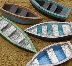 Rowena Brown. Rowboat London.  Ceramic boats, part glazed and raku fired. Hand made and hand fired. length 14 cm  height 3.5 cm  width 6 cm