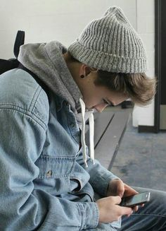 Cute hipster boy with style and a beanie.