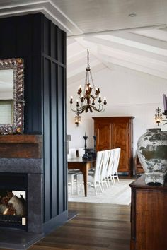 Black accent wall in center. dark fireplace dividing room - Waiheke Island NZ home of designer Anna Desbonnets Concrete Fireplace, Fireplace Wall, Fireplace Surrounds, Fireplace Design, Double Sided Fireplace, Lounge, Industrial House, Layout, Black Decor