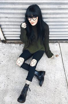 Glasses with green sweater, ripped black pants, fishnet tights & Dr Martens boots by jaglever