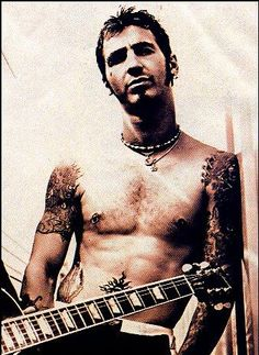 Saw Sully Erna up close at a concert once, and pictures just don't do him justice. Plus, I love a tattooed guy!