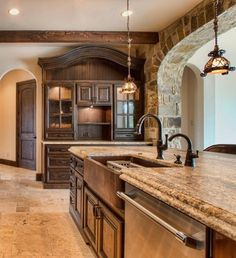 kitchen--love the big copper sink, false beams, & the color of the counter tops!!