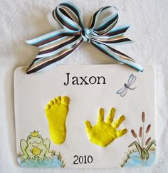 Could make one large salt dough impression with both hand and foot impressions on one. Frame in shadow box.