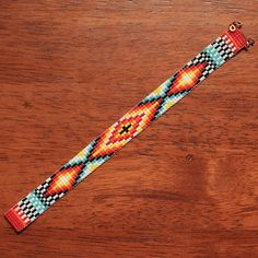 This Desert Mirage Bead Loom bracelet was inspired by all the beautiful Native and Latin American patterns I see around me in Albuquerque, New Mexico. As with all my pieces, Ive created it on a bead loom with great care and attention to detail. The beads used in this piece are my favorite