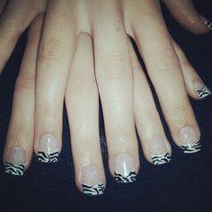 gel nails...glitter gel base, white tips w/ freehand design