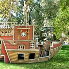 I wish we could do this for Jack ... Children's own pirate boat, way cooler than your ordinary backyard playground