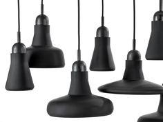 Black Interior - Brokis lights - Black Mat Shadows are hanging lights. The designer Lucie Koldova and Dan Yeffet.